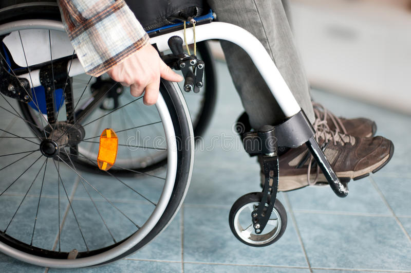 Wheelchair user. Makes various movements with his wheelchair, exercises for safety handling royalty free stock photo