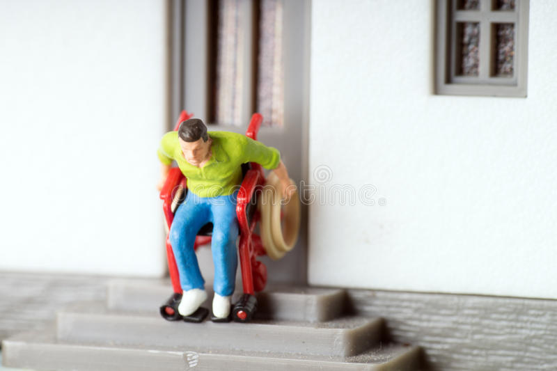 Wheelchair user. On an exterior staircase stock image
