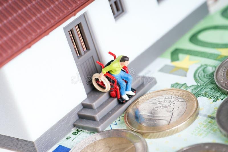 Wheelchair user. On an exterior staircase and euro money stock photo