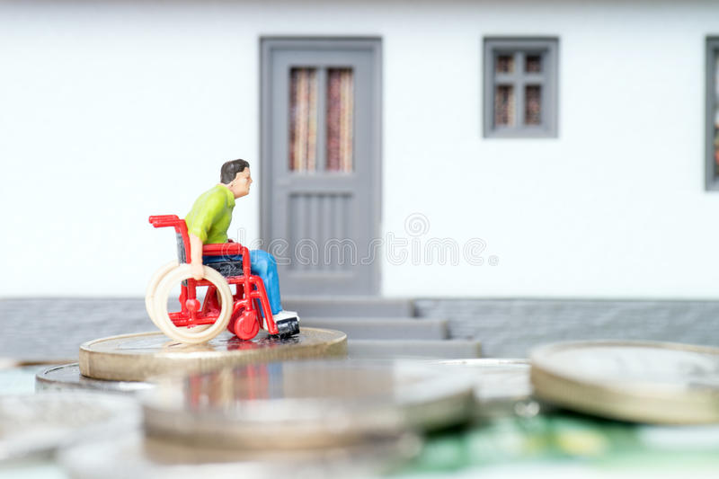 Wheelchair user. In front of a house royalty free stock images