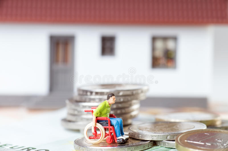Wheelchair user. In front of a house royalty free stock photography
