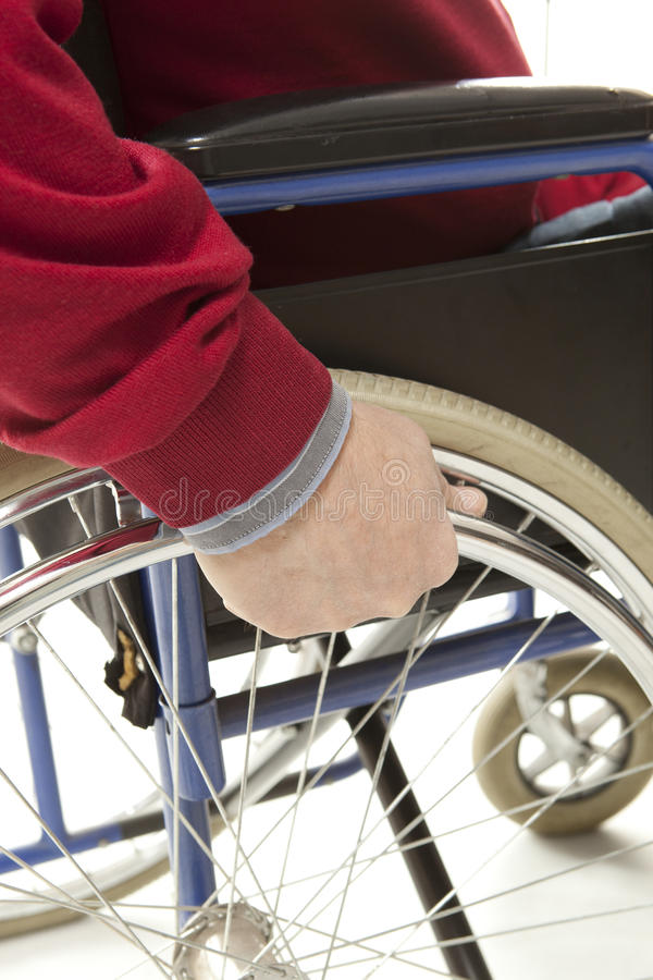 Wheelchair. User makes various movements with his , exercises for safety handling stock image