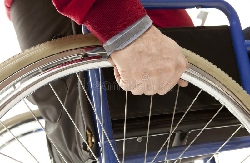 Wheelchair. User makes various movements with his , exercises for safety handling stock photography