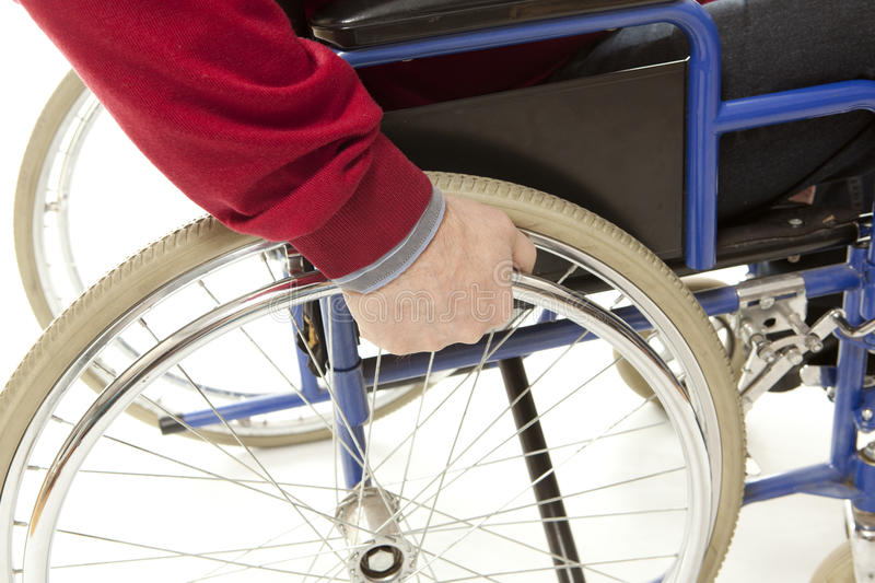 Wheelchair. User makes various movements with his , exercises for safety handling stock photo