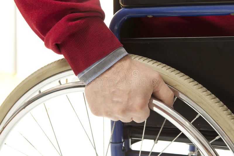 Wheelchair. User makes various movements with his , exercises for safety handling royalty free stock photos