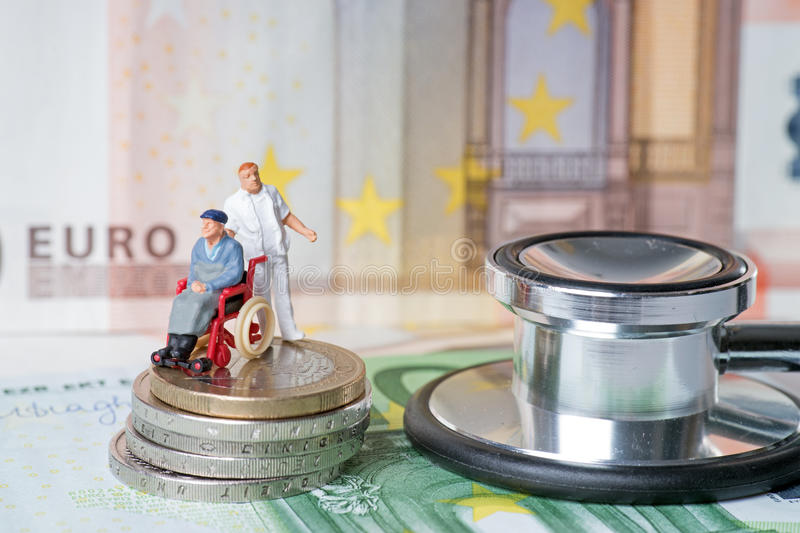 Wheelchair user. With nursing staff and euro money with stethoscope royalty free stock photos