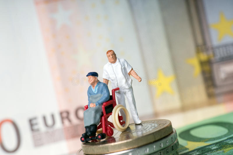 Wheelchair user. With nursing staff and money stock photo
