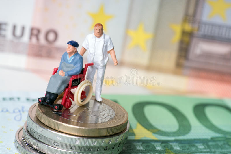 Wheelchair user. With nursing staff and money stock photos