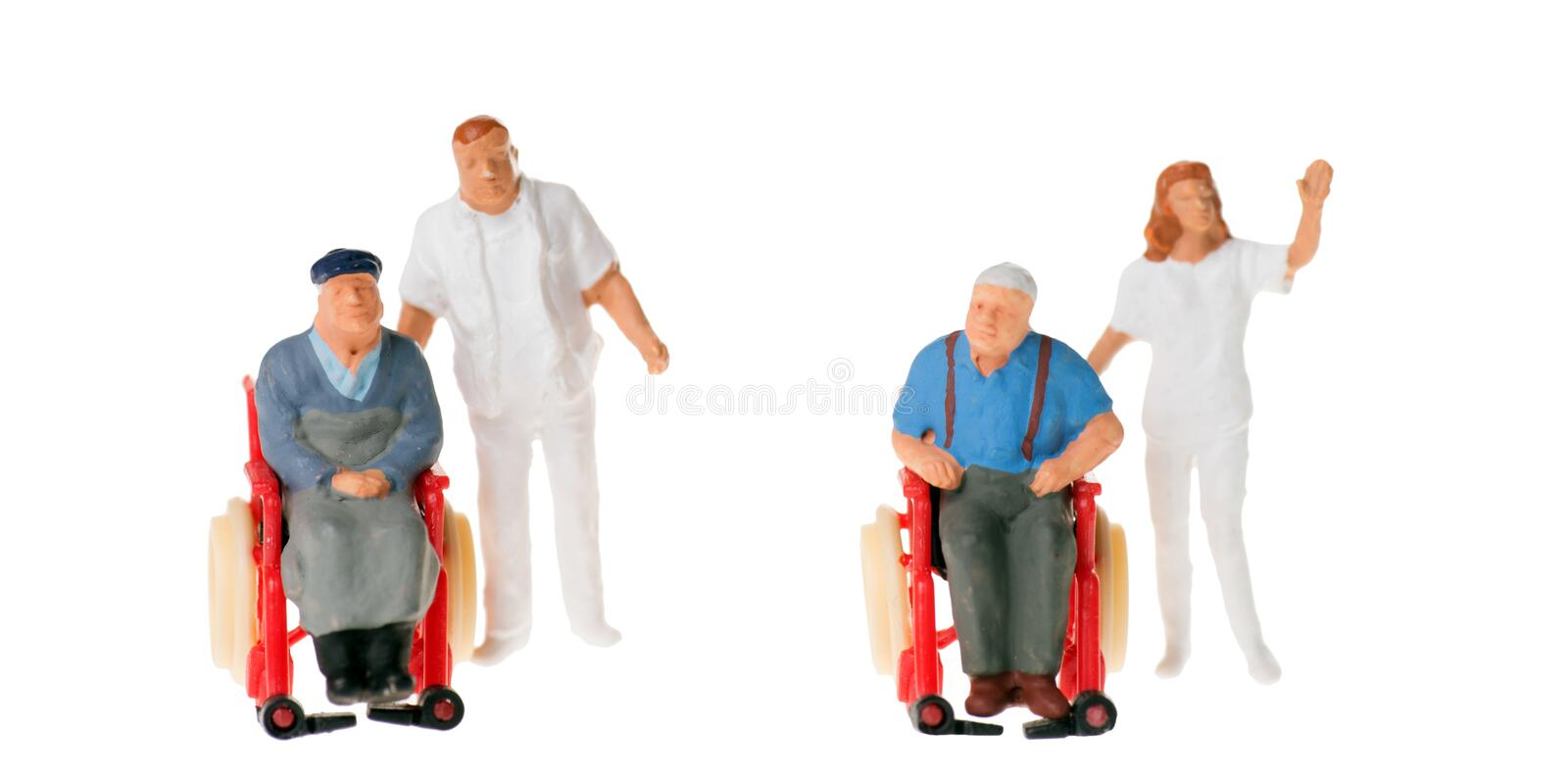 Wheelchair user. With nursing staff over a white background stock image