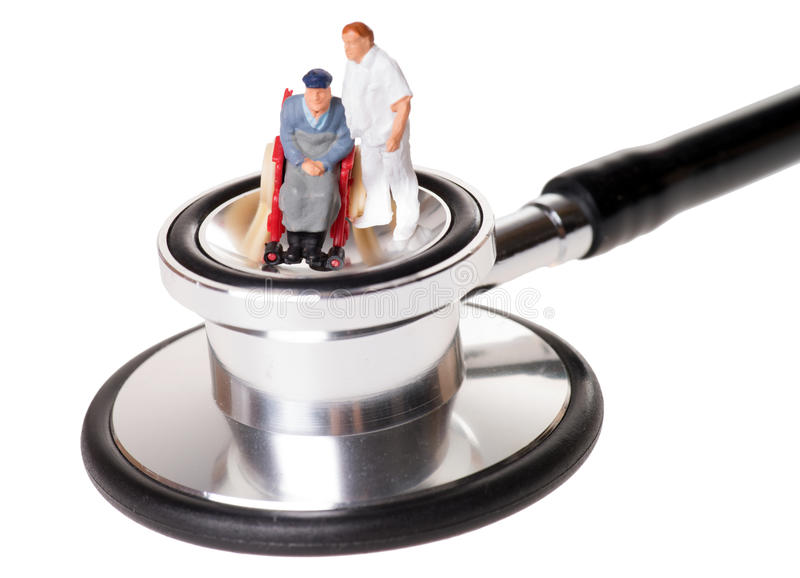 Wheelchair user. With nursing staff stethoscope royalty free stock images