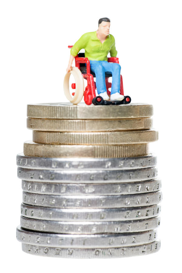 Wheelchair user. On a stack of euro coins isolated over a white background stock photography