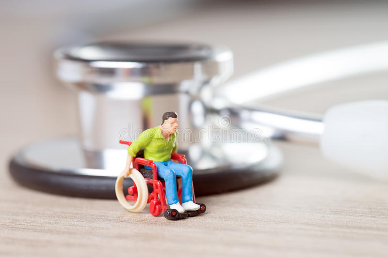 Wheelchair user. And a stethoscope stock photos