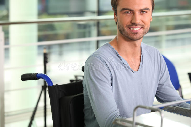 Wheelchair user working. At a desk royalty free stock photo