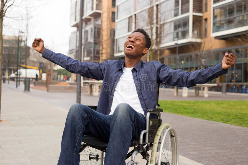 Wheelchair. A young wheelchair user celebrating stock images