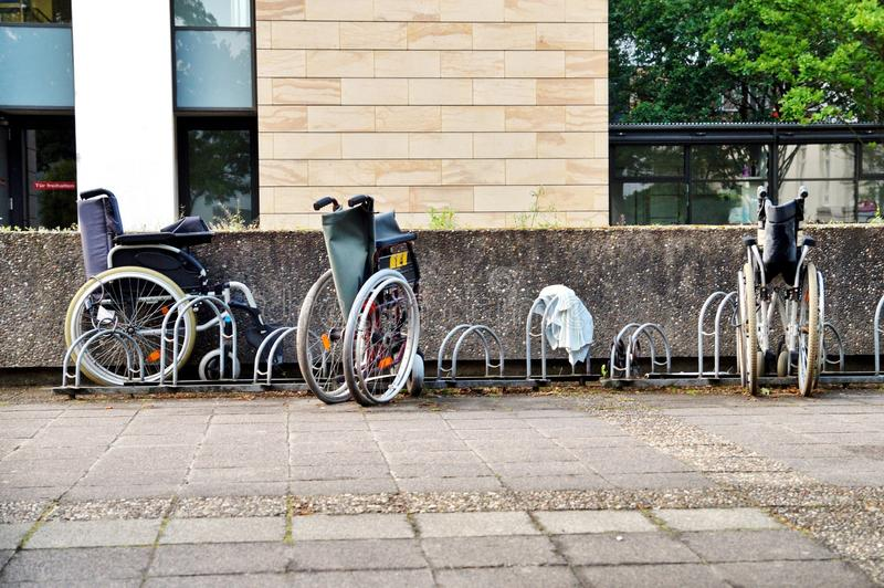 Wheelchairs for the disabled parking in a hospital with old condition. Breakdown is not available. stock photos