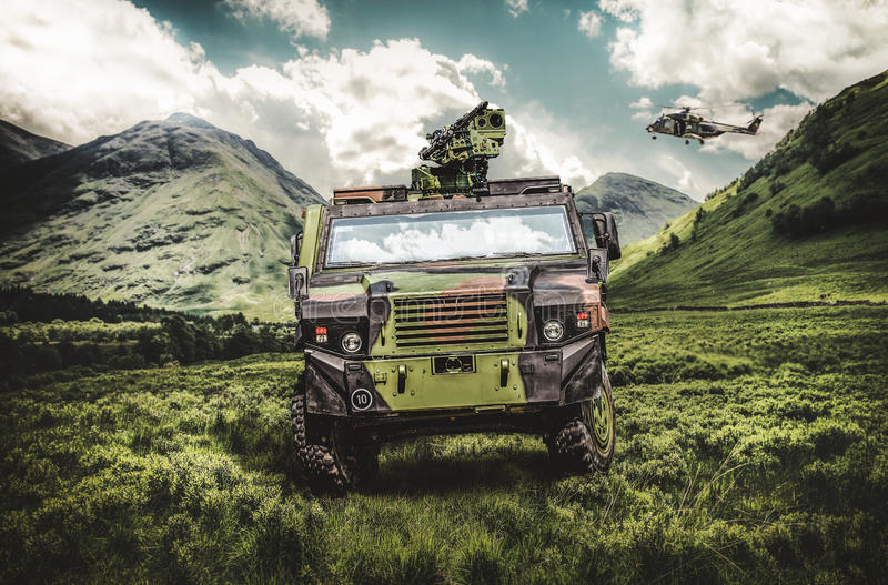 Wheeled armored vehicle with a transport helicopter. Wheeled armored vehicle and a transport helicopter stock image