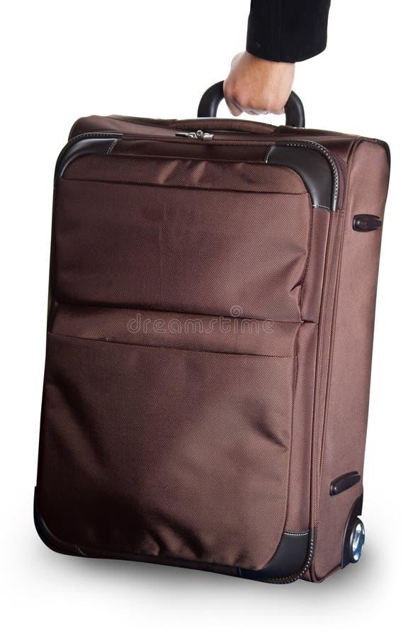 Wheeled luggage. Brown wheeled luggage isolated on white stock photography