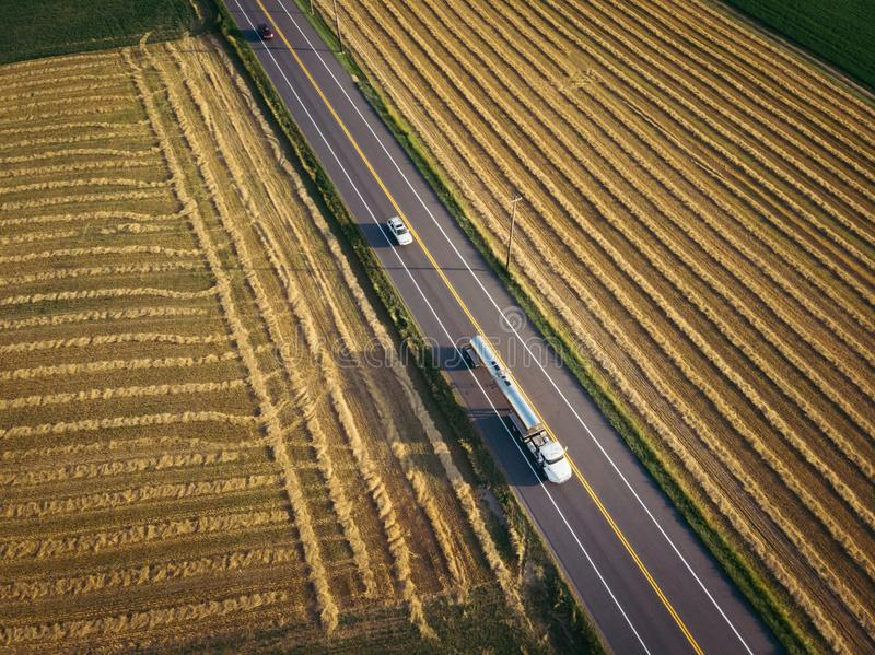 18 wheeler semi-truck fuel tanker on highway aerial view royalty free stock photos