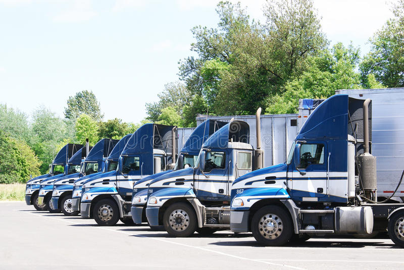 Download 18 Wheelers Parked In A Row. Stock Image - Image of goods, freight: 31676919