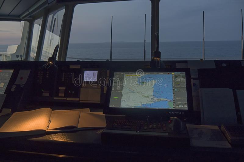 Wheelhouse in modern ship with ECDIS and Bridge Log book stock images