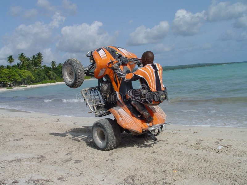 Wheelie on the beach royalty free stock images