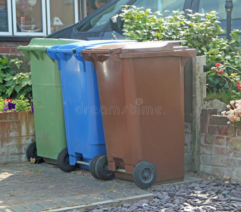Wheelie Bins. This photo shows three wheelie bins royalty free stock photography