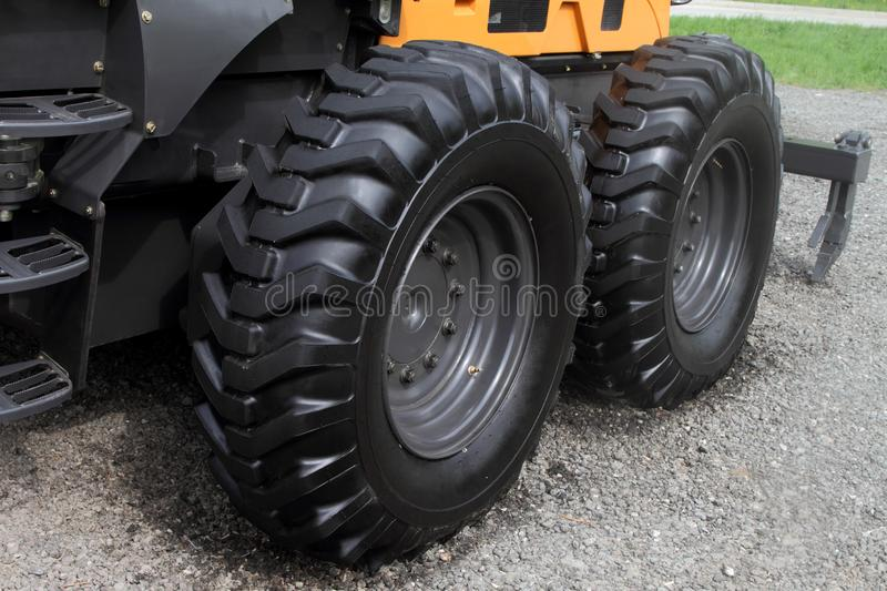 Wheels with a high protector of tractor stock photo