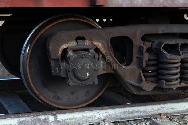 Freight train wheels on rails royalty free stock photo