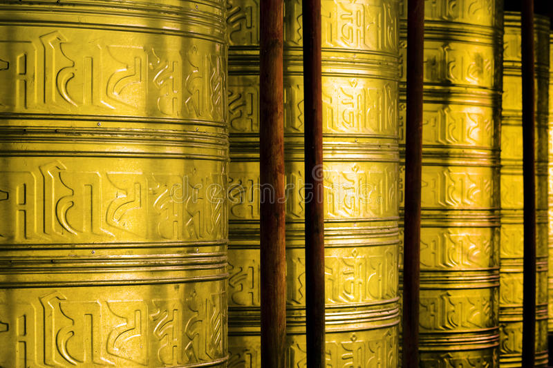 Wheels for prayers in buddhist temple royalty free stock photo