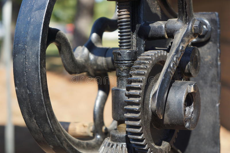 Wheels and sprockets of vintage drill. Wheels, gears and sprockets of vintage machine stock image