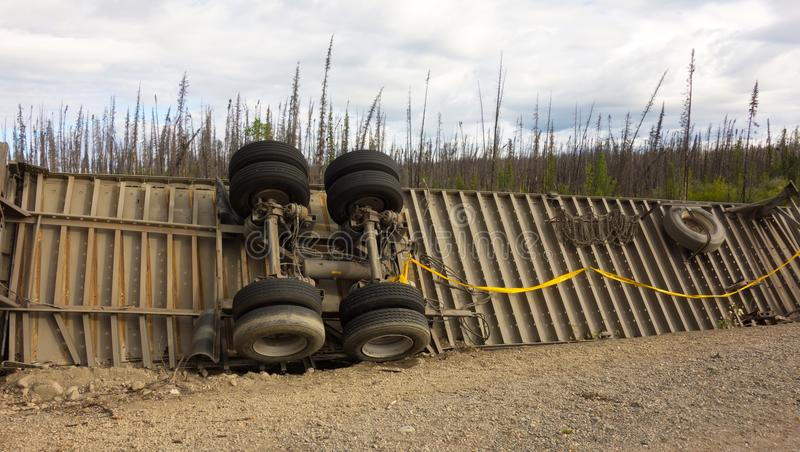 The underside of a crashed trailer in a remote part of british columbia. The wheels of a trailer at an accident scene along the challenging cassiar highway in royalty free stock photography