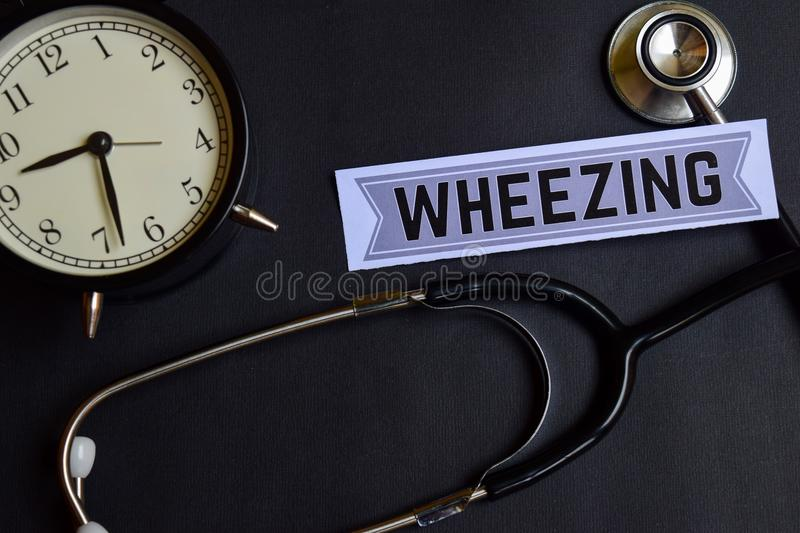 Wheezing on the paper with Healthcare Concept Inspiration. alarm clock, Black stethoscope. royalty free stock images