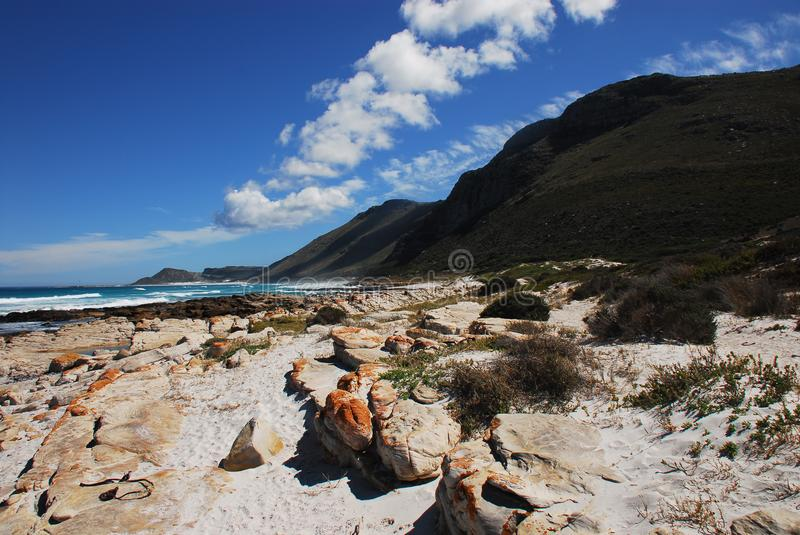 Africa- Beautiful Scarborough Beach, South Africa. Where the beautiful cliffs meet the Sea. A panoramic landscape of Scarborough Beach, South Africa royalty free stock image