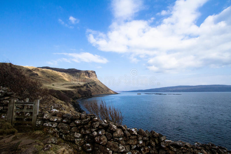 Where the Mountains meet the Sea. The majestic mountains of Scotland's Isle of Skye reach towards the ocean stock photography