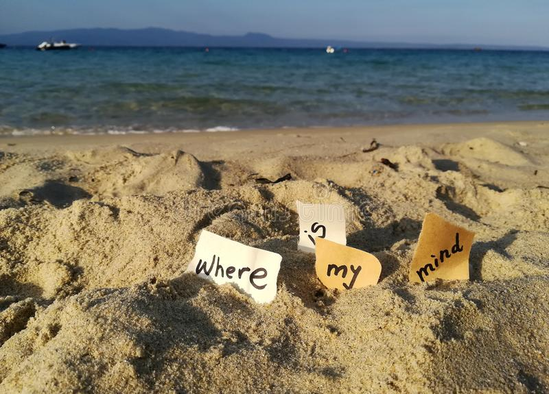 Where is my mind. The inscription `Where is my mind` found in the sand of Alykes Beach, on Ammouliani Island, Halkidiki, Greece stock photos