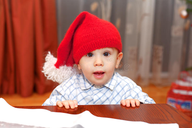 Where is my present?. Small baby is asking for a present royalty free stock photo