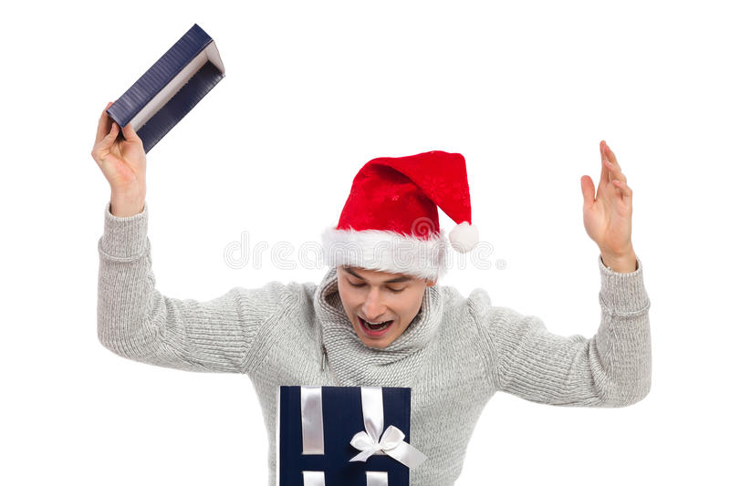 Where is my present?. Young man in santa's hat opening a gift and shouting. Studio portrait isolated on white stock photos