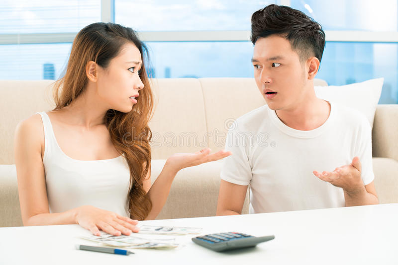 Where is our money?. Image of a young couple having a quarrel about money royalty free stock photos