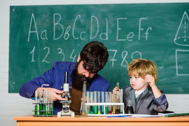 Where Students Are Achievers. father and son at school. school kid scientist studying science. Back to school. teacher royalty free stock image
