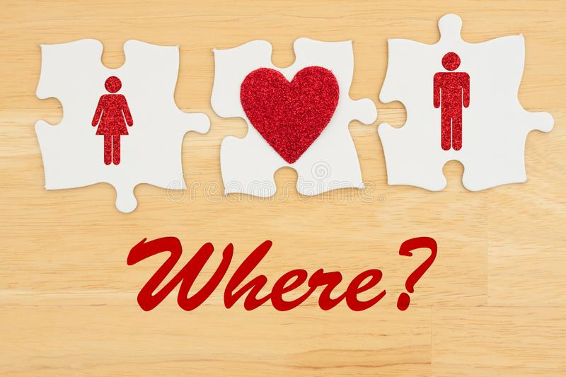 Where to find love, Three puzzle pieces with a heart and a man and woman royalty free stock photo