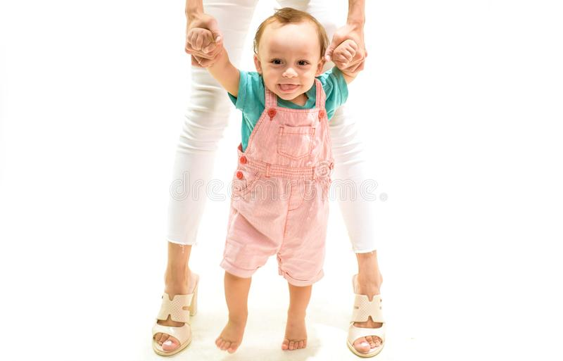 Where to go next. Little boy child develop gross motor activity. Adorable small toddler. Cute little baby learn to walk. Small child walking with help, motor royalty free stock image
