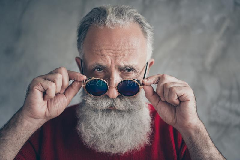 Where you 2020. Close up photo of brutal serious old man touch his trendy specs look gorgeous on christmas time wear red. Trendy jumper, isolated over grey stock image