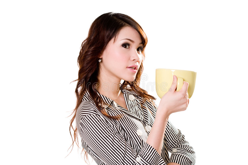 Wheres my coffee. Young woman holding a big green cup thinking royalty free stock photo