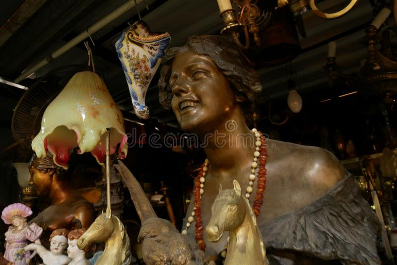 Sculpture of a smiling woman for sale at the San Telmo Market, Buenos Aires, Argentina. Whether you`re looking for a vintage leather coat, an old Elvis record or stock photography
