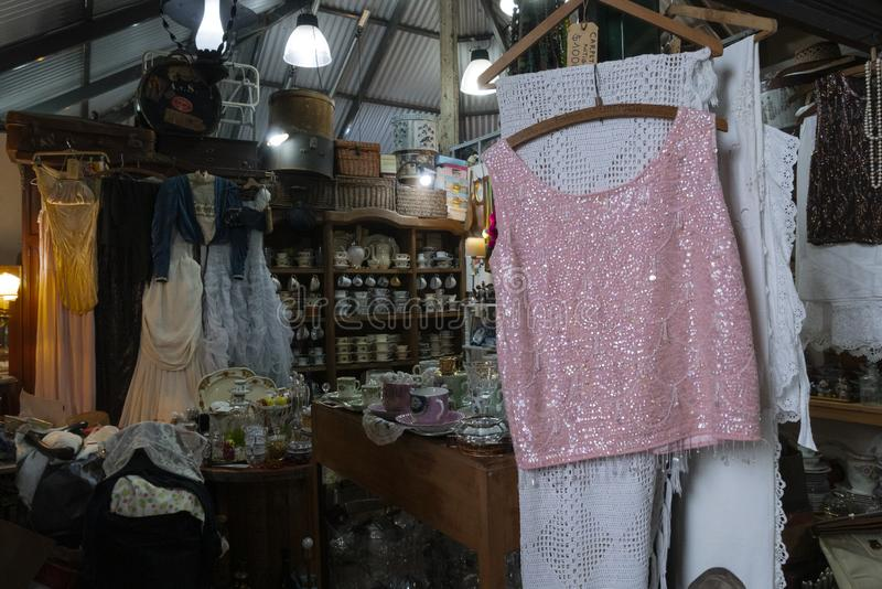 Old clothes for sale at San Telmo Market, Buenos Aires, Argentina. Whether you`re looking for a vintage leather coat, an old Elvis record or fresh produce to stock image