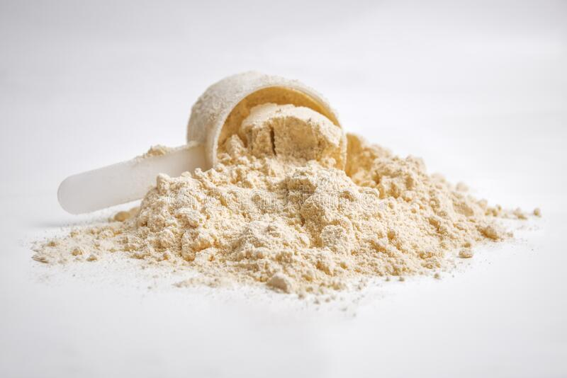 Whey protein on white stock photography