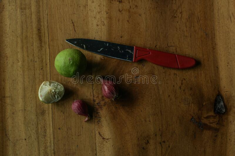 Lime onion and knife. Which must be available in the kitchen as a spice in cooking royalty free stock photography