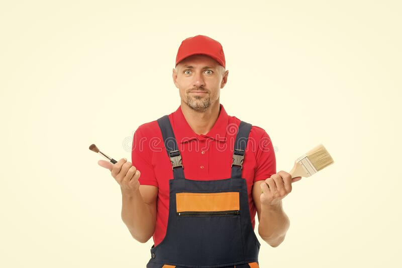 Which one. Decorator creative work. Paint and renovate. Decorator painting wall. Man hold brushes white background. Worker painter decorator concept stock images