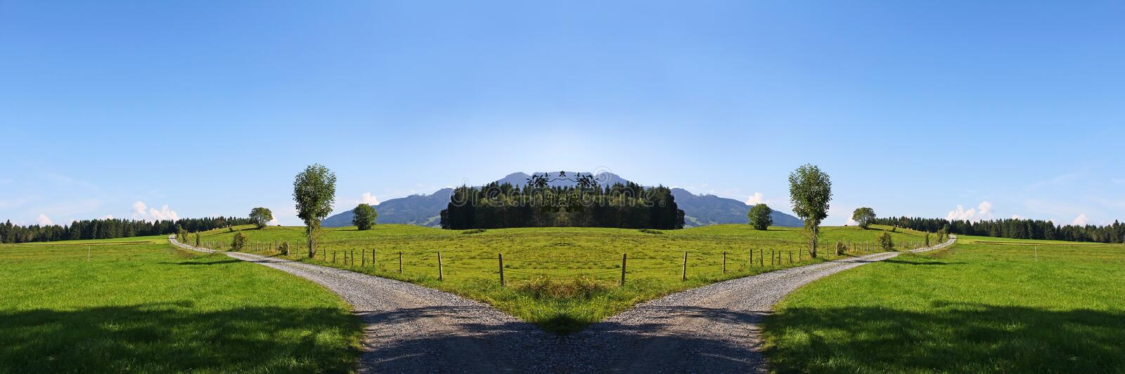 Which way should we go?. Summer landscape with path royalty free stock photography