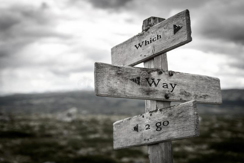 Which way to go wooden signpost outdoors in nature. stock photography